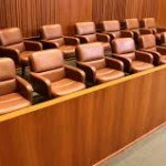 picture of jury box with empty chairs