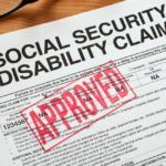 """Social Security Disability claim form stamped """"Approved"""""""