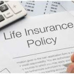 copy of Life Insurance Policy with calculator and glasses