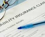 picture of disability insurance claim form with pen