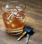 Picture of alcoholic drink next to car keys